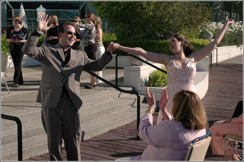 Jessyca and Mitch perform a post-ceremonial hooray during their rehersal.